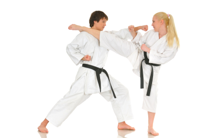 Young adult couple practicing Karate on white background, studio shot. Series.